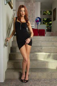 Playful Brunette Pulling Her Dress